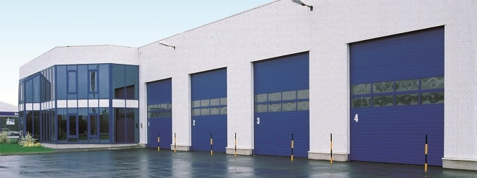 Sectional Overhead Doors - Blue in courtyard